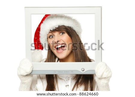 Laughing girl in Santa hat broadcasting Christmas news from TV / computer screen, isolated on white background. Christmas news.