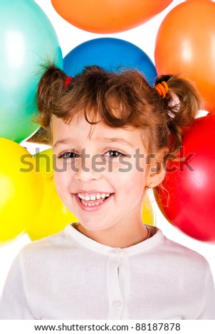 laughing girl on the background of color balloons