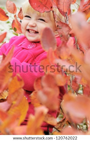 laughing girl standing in bushes