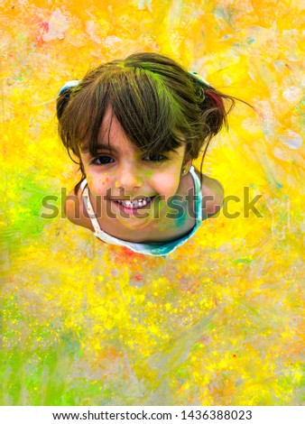 Laughing girl with paint stained her face. Child laughs happily enjoying active games and creativity. Head thrown back, top view, copy space for your text. Back to school #1436388023