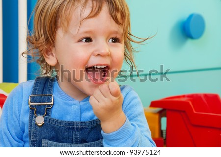 Laughing kid portrait with room on background