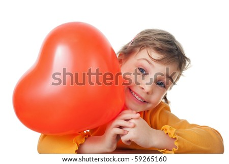 laughing little girl holds heart shape balloon isolated on white background