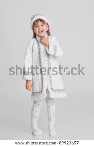 Laughing little girl in a Snow-maiden fancy dress isolated on white