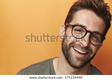 Laughing man in spectacles, portrait - Shutterstock ID 575234440