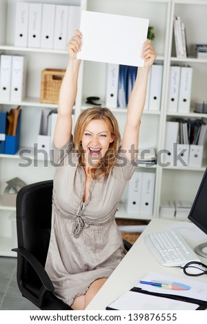 Laughing mid adult businesswoman holding blank paper