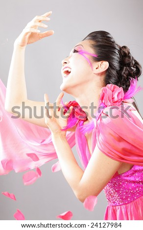 Laughing model in pink