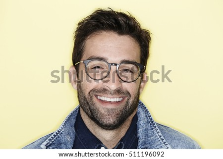 Laughing model with stubble and glasses, portrait - Shutterstock ID 511196092