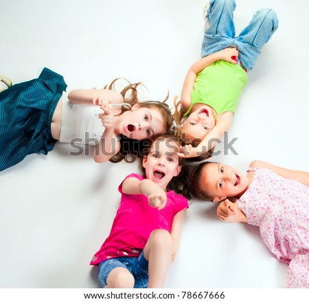 laughing small kids on a light background
