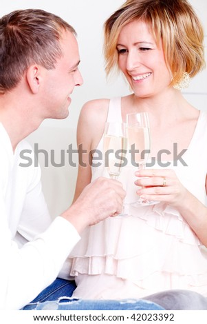Laughing smiling flirting couple cheering with champagne being in love
