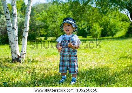 Laughing toddler portrait in a park - stock photo
