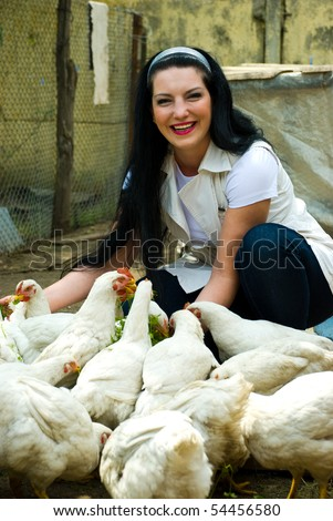 stock photo laughing woman feeding big farm chickens and having fun 54456580 ... hole right through the middle of it. One can almost imagine using it as ...
