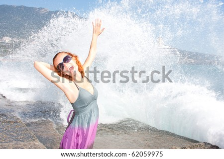 Laughing woman in glasses on the beach