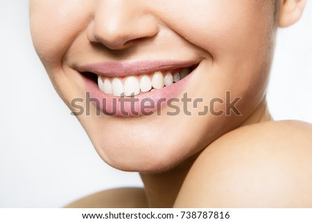 Laughing woman mouth with great teeth over white background. Healthy beautiful female smile. Teeth health, whitening, prosthetics and care. #738787816