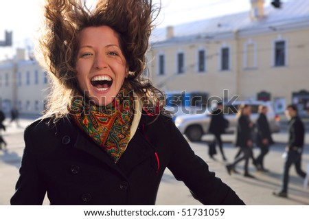 laughing woman on spring city street
