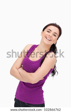 Laughing woman with folded arms against white background