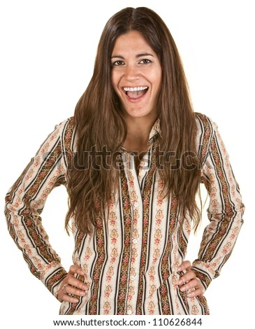 Laughing woman with long hair and hands on hips