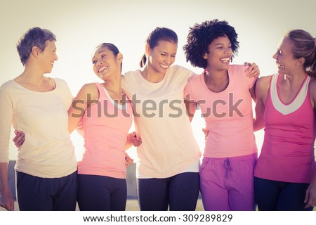 Shutterstock Laughing women wearing pink for breast cancer in parkland