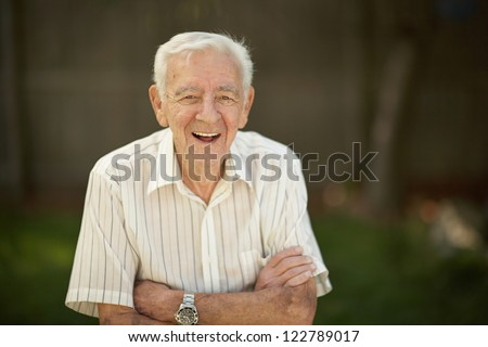 Laughing 90 year old senior elder man outside