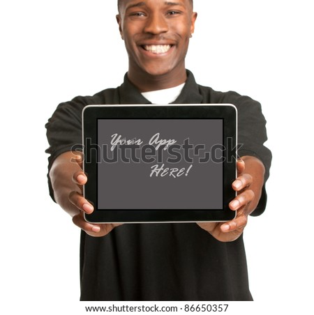 Laughing Young African American Male Holding a Touch Pad Tablet PC on Isolated White Background