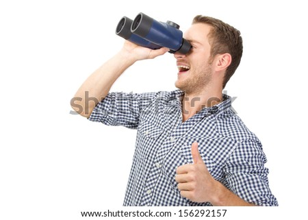 Laughing young man looking into binocular and showing alright