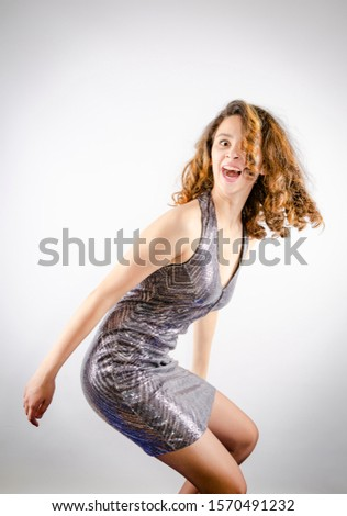 Laughing Young Woman in evening dress - new year, celebration. Crazy crazy party concept. Copy space