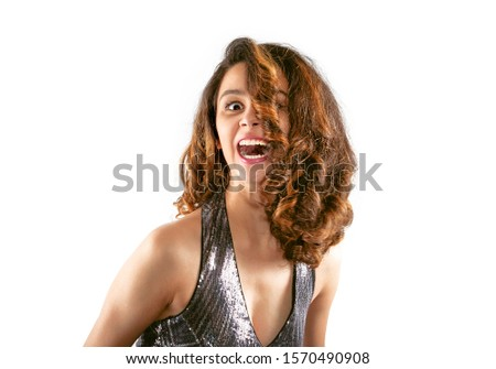 Laughing Young Woman in evening dress - new year, celebration. Crazy crazy party concept. Isolated on white.