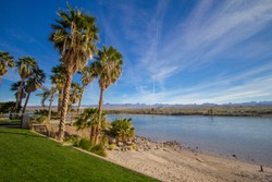 Laughlin Nevada Waterfront. Beach with a grove of palm trees on the Colorado River in the waterfront district of Laughlin Nevada.