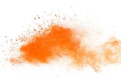 Launched orange powder on black background