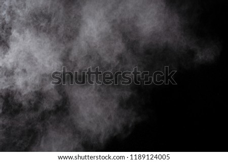 Launched white powder, isolated on black background. #1189124005
