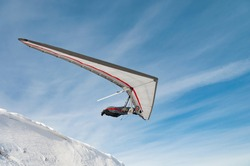 Launching hang glider pilot. Learning extreme sport. Extreme sport activity. Dream to fly and free flight concept
