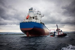 launching of renovated tanker cargo ship from dock to water.