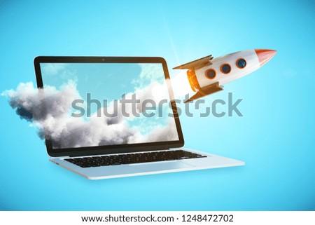 Launching rocker on laptop screen. Blue background. Online start up concept. 3D Rendering  Stock photo ©