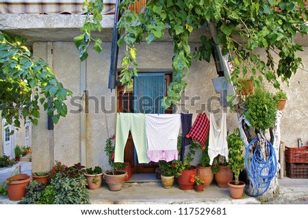 Laundry and flowers before a residential building in Mirtos on Crete
