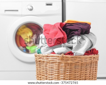 Shutterstock Laundry basket on the background of the washing machine.
