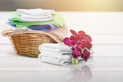 Laundry Basket with colorful towels on desk