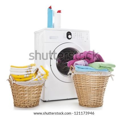 Laundry baskets and washing machine isolated on white background