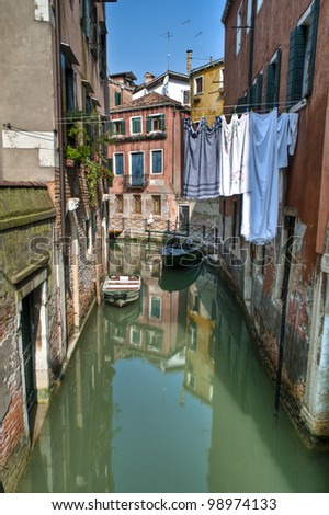 Laundry drying above a canal in Venice, Italy