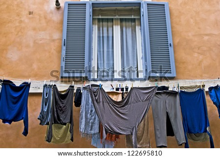 Laundry hanging out of a typical Italian facade, Rome, Lazio, Italy