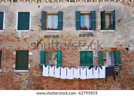 Laundry hanging out of a typical Venetian facade. Italy