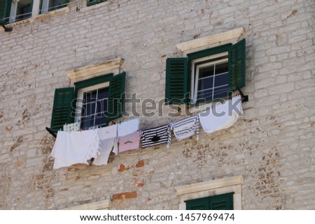 Laundry hangs on the window to dry