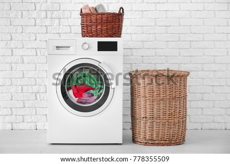 Laundry in washing machine indoors #778355509