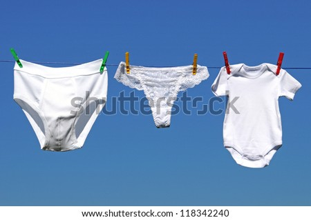 Laundry line with mens underpants, thong and baby-body