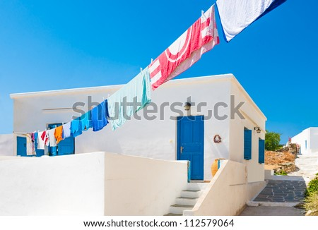 Laundry line with washed clothes outside a Greek island house in the Cyclades