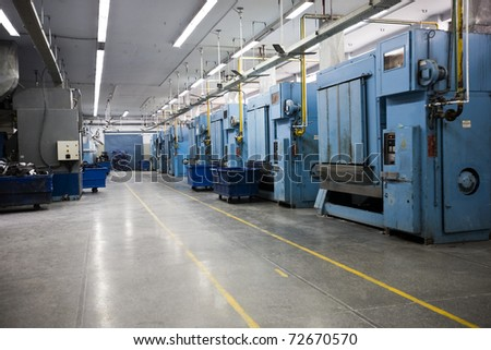 laundry machines at a factory for washing the garments in bulk.