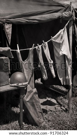 Laundry on the Line - Army tent with line of military issue clothing drying in the sun
