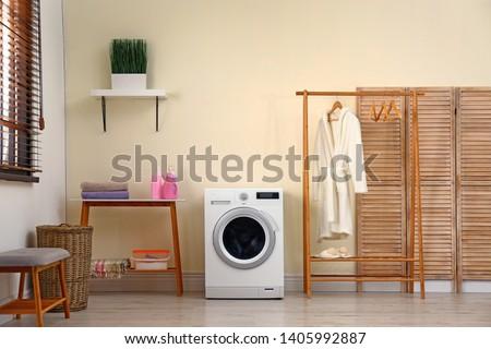 Laundry room interior with modern washing machine