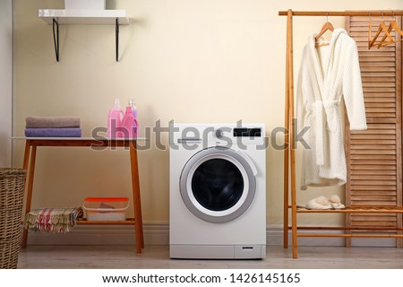 Laundry room interior with modern washing machine #1426145165