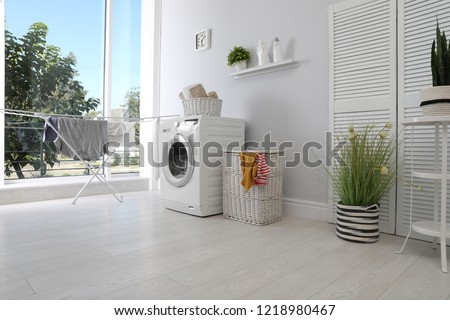 Laundry room interior with washing machine near wall #1218980467