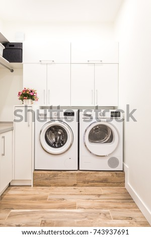 Laundry room with washing and drying machines #743937691