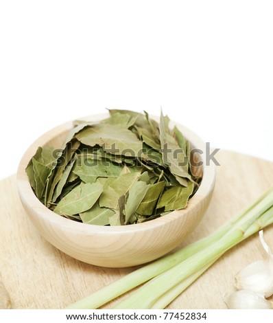 laurel leafs in a wooden board